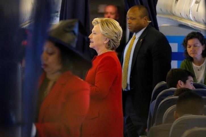 U.S. Democratic presidential nominee Hillary Clinton boards her campaign plane in North Canton, Ohio, U.S. October 31, 2016.  REUTERS/Brian Snyder