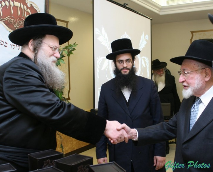 FILE - Shenker greeting Grand Rabbi Chaim Shaul Taub of Modzitz, present Modzitzer Rebbe on Feb 6, 2011. ( Shimon Gifter/VINnews.com)