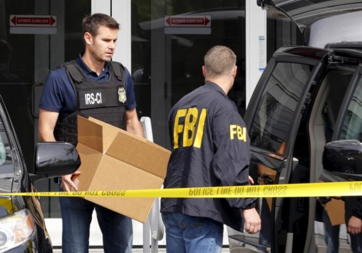 FILE - FBI agents remove boxes and other items from the offices of Imagina in Miami, Florida December 3, 2015.   REUTERS/Joe Skipper