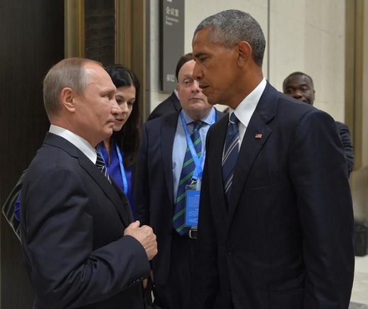 FILE - Russian President Vladimir Putin (L) meets with U.S. President Barack Obama on the sidelines of the G20 Summit in Hangzhou, China, September 5, 2016. Sputnik/Kremlin/Alexei Druzhinin/via REUTERS