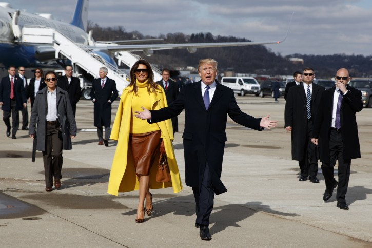 President Donald Trump and first lady Melania Trump walk to greet supporters after arriving at Cincinnati Municipal Lunken Airport, Monday, Feb. 5, 2018, in Cincinnati. (AP Photo/Evan Vucci)