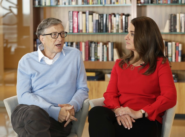 In this Feb. 1, 2018 photo, Microsoft co-founder Bill Gates and his wife Melinda take part in an AP interview in Kirkland, Wash. Gates and his wife head the Bill and Melinda Gates Foundation, and are rethinking their work in America as they confront what they consider an unsatisfactory track record, the country's growing inequity and a president they disagree with more than any other. (AP Photo/Ted S. Warren)