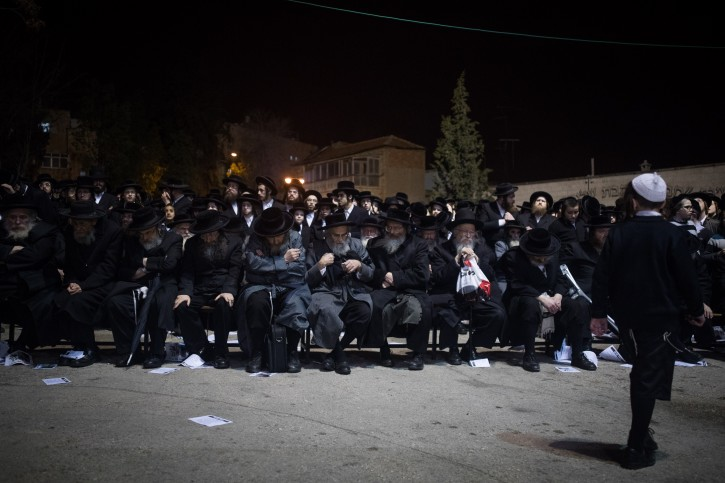 Ultra orthodox Jewish men attend a protest against the recruitment of religious girls to the Israeli army, in Jerusalem's Mea Shearim neighbourhood on February 12, 2018. Photo by Yonatan Sindel/Flash90