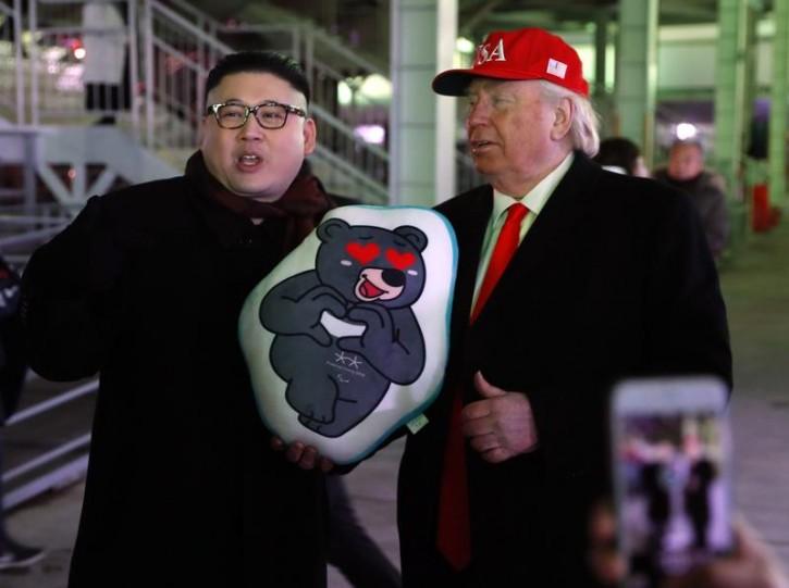 FILE -  Two men dressed as look-a-likes of U.S. President Donald Trump and North Korean leader Kim Jong Un pose. REUTERS/Leonhard Foeger - DEVEE2P0ZKAGI