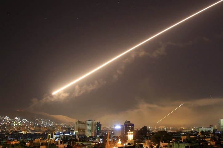 Damascus skies erupt with service to air missile fire as the U.S. launches an attack on Syria targeting different parts of the Syrian capital Damascus, Syria, early Saturday, April 14, 2018. Syria's capital has been rocked by loud explosions that lit up the sky with heavy smoke as U.S. President Donald Trump announced airstrikes in retaliation for the country's alleged use of chemical weapons. (AP Photo/Hassan Ammar)