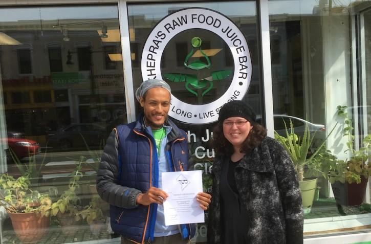 Maharat Ruth Friedman with the manager of Khepra's Raw Food Juice Bar, a vegan restaurant she and Rabbi Shmuel Herzfeld recently certified kosher. (Courtesy of Friedman)