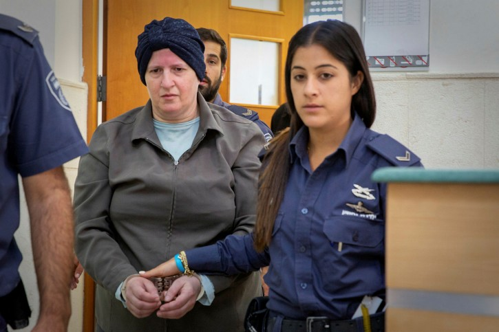 Malka Leifer, a former school principal who is wanted on 74 charges of abuse in Melbourne, Australia, is led out of the Jerusalem District Court. Jun 14, 2018. Photo by: Hillel Maeir/TPS