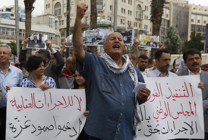 Palestinians attend a protest to demand lifting the sanctions on Gaza Strip, in the West Bank city of Ramallah, Tuesday, June 12, 2018. AP
