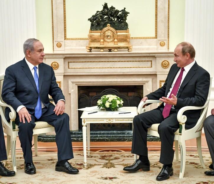 Russian President Vladimir Putin, right, speaks with Israeli Prime Minister Benjamin Netanyahu during their meeting at the Kremlin in Moscow, Wednesday, July 11, 2018. (Yuri Kadobnov/ Pool photo via AP)