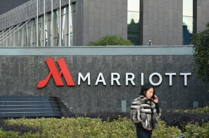 FILE - A woman on a mobile phone walks past a Marriott hotel in Hangzhou, Zhejiang province, China January 11, 2018. Picture taken January 11, 2018. REUTERS/Stringer