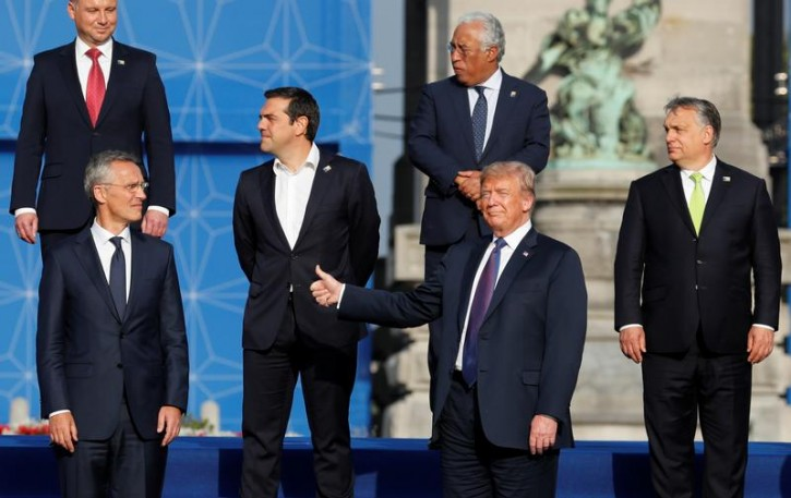 NATO Secretary General Jens Stoltenberg, Poland's President Andrzej Duda, Greek Prime Minister Alexis Tsipras, U.S. President Donald Trump, Portugal's Prime Minister Antonio Costa, Hungarian Prime Minister Viktor Orban pose for a group photo in the park of the Cinquantenaire, during a NATO Summit, in central Brussels, Belgium July 11, 2018.  REUTERS/Yves Herman