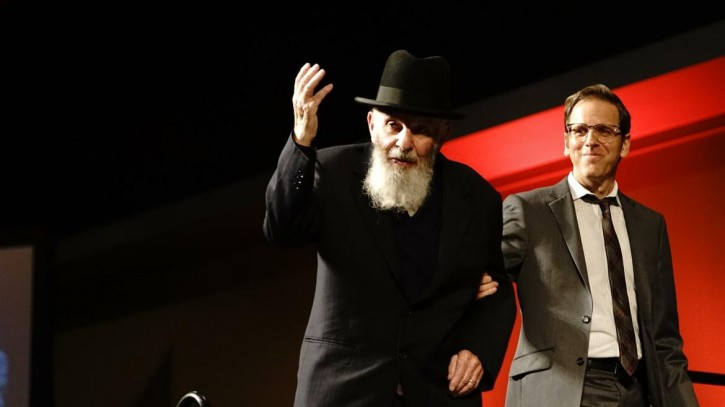 FILE - Nissan Krakinowski waves as he arrives to recount his survival of the Holocaust in June in Spokane Washington. (Photo courtesy: The Spokesman-Review)
