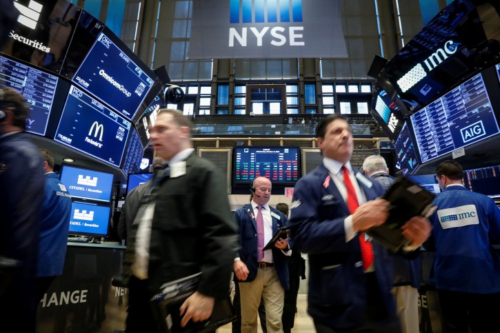 Traders work on the floor of the New York Stock Exchange (NYSE) in New York, U.S., October 3, 2018. REUTERS/Brendan McDermid
