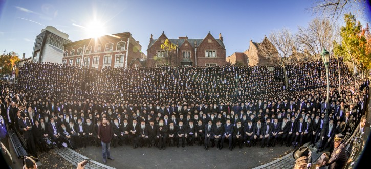 Thousands of rabbis pose for a group photo in front of Chabad-Lubavitch world headquarters in the Brooklyn borough of New York, Sunday, Nov. 4, 2018. They are among 4,700 rabbis from around the world who are in New York for the International Conference of Chabad-Lubavitch Emissaries, an annual event aimed at reviving Jewish awareness and practice around the world.