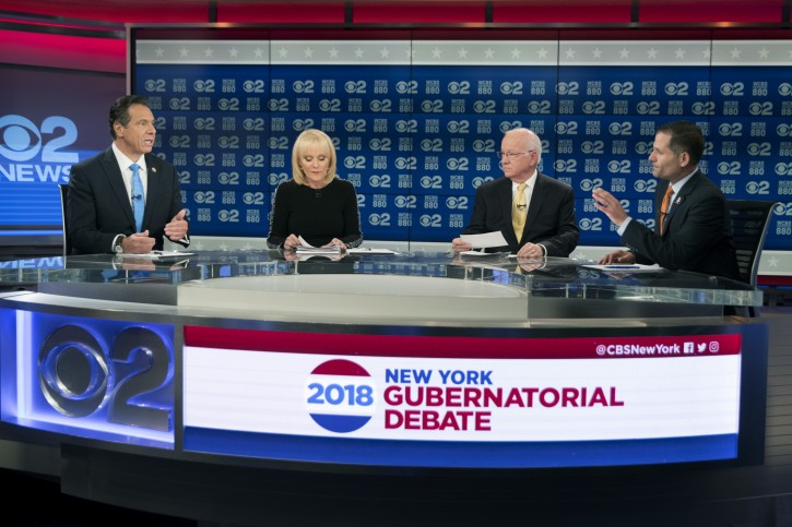 FILE - New York Gov. Andrew Cuomo, left, and Republican gubernatorial candidate Marc Molinaro, right, argue during the New York gubernatorial debate hosted by CBS 2 chief political correspondent Marcia Kramer, second from left, and WCBS Newsradio 880 reporter Rich Lamb, Tuesday, Oct. 23, 2018 in New York.  (AP Photo/Mary Altaffer, Pool)