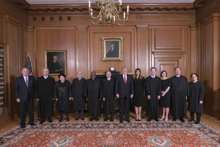 In this image provided by the Supreme Court, President Donald Trump poses for a photo with Associate Justice Brett Kavanaugh in the Justices' Conference Room before a investiture ceremony Thursday, Nov. 8, 2018, at the Supreme Court in Washington. From left are, retired Justice Anthony Kennedy, Associate Justices Neil Gorsuch, Sonia Sotomayor, Stephen Breyer, Clarence Thomas, Chief Justice John Roberts, Jr., President Donald Trump, first lady Melania Trump, Associate Justice Brett Kavanaugh, Ashley Kavanaugh, and Associate Justices Samuel Alito, Jr. and Elena Kagan. (Fred Schilling/Collection of the Supreme Court of the United States via AP)