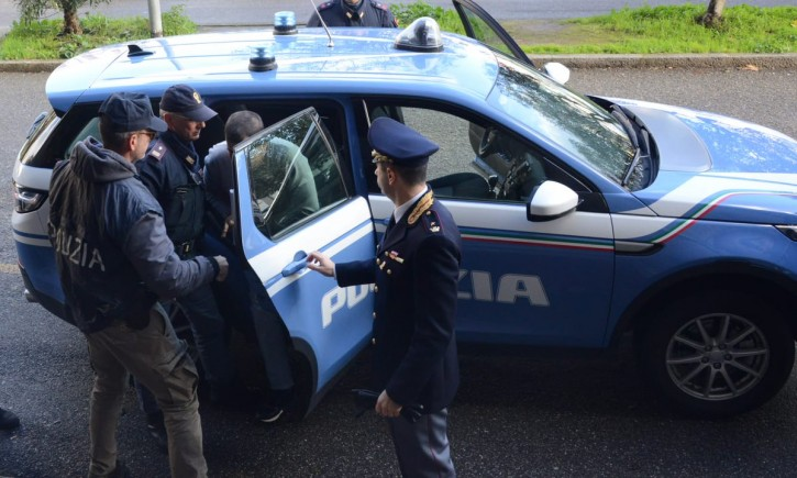 Italian Security posted this photo of the suspected man being arrested
