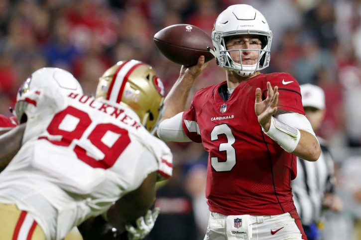 Arizona Cardinals quarterback Josh Rosen (3) throws as San Francisco 49ers defensive tackle DeForest Buckner (99) pursues during the second half of an NFL football game, Sunday, Oct. 28, 2018, in Glendale, Ariz. (AP Photo/Ralph Freso)