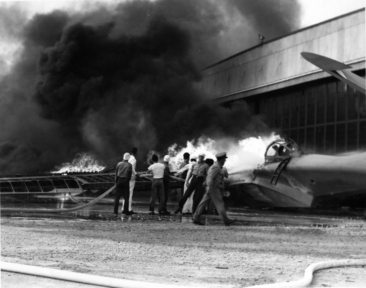 FILE - In this Dec. 7, 1941 file photo provided by the U.S. Navy, a patrol bomber burns at a military installation on Oahu's Kaneohe Bay during the Japanese attack on Pearl Harbor in Hawaii. AP