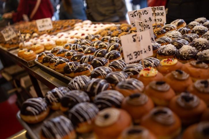 Doughnuts (sofganiot) on sale at the Roladin bakery in Jerusalem, during the Jewish holiday of Hanukkah, December 5, 2018. Photo by Aharon Krohn/Flash90