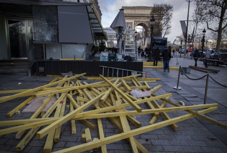 Workers dismantle wooden beams used to protect and reinforce shop windows on the Champs Elysees, the day after the 08 december yellow Vests (Gilets jaunes) clashes with French police forces during a demonstration in Paris, France, 09 December 2018. EPA