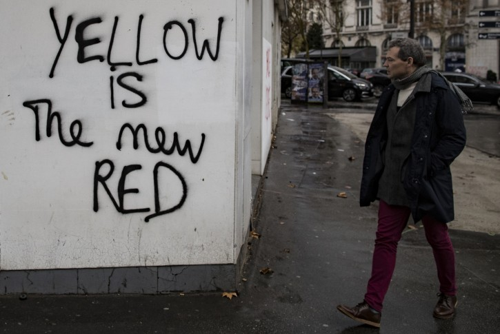Graffiti sprayed on a wall reads 'Yellow is the new red', the day after the 08 december yellow Vests (Gilets jaunes) clashes with French police forces during a demonstration in Paris, France, 09 December 2018.  EPA