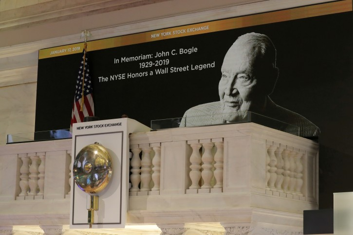 FILE PHOTO: A tribute to Jack Bogle, founder and retired CEO of The Vanguard Group, is displayed on the bell balcony over the trading floor of the New York Stock Exchange (NYSE) in New York, U.S., January 17, 2019. REUTERS/Brendan McDermid