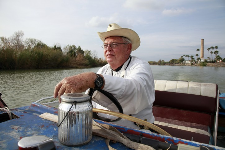 In this Tuesday, January 8, 2019 photo, father Roy Snipes, pastor of the La Lomita Chapel, shows Associated Press journalists the land on either side of the Rio Grande at the US-Mexico border on Tuesday January 8, 2019 in Mission, Texas. Portions of Father Snipes' church land in Mission could be seized by the federal government to construct additional border wall and fence lines.  (AP Photo/John L. Mone)