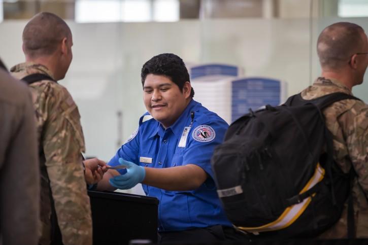 A Transportation Security Administration (TSA) agent checks the identification of air travelers at Ronald Reagan Washington National Airport in Arlington, Virginia, USA, 07 January 2019. EPA