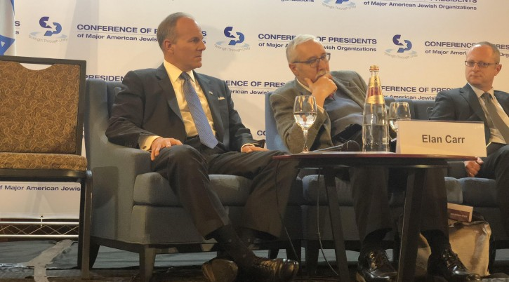 Elan Carr, left, the U.S. State Department's new envoy on anti-Semitism, speaks to delegates of the Conference of Presidents of Major American Jewish Organization in Jerusalem, Feb. 21, 2019. To his left are Gerald Steinberg, president of NGO Monitor, and Ron Brummer of Israel's Ministry of Strategic Affairs. (Sam Sokol)</p>  <p>