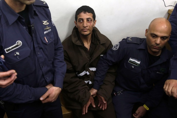 Palestinian Arafat Erfaiyeh, center, sits at a courtroom in Jerusalem, Monday, Feb. 11, 2019.  (AP Photo/Mahmoud Illean)