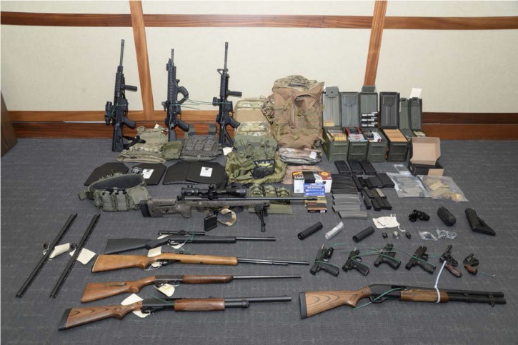 This image provided by the U.S. District Court in Maryland shows a photo of firearms and ammunition that was in the motion for detention pending trial in the case against Christopher Paul Hasson. AP