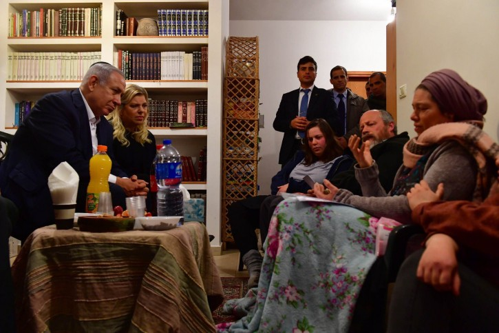 Prime Minister Benjamin Netanyahu visits the family of teenage girl Ori Ansbacher, who was killed in a suspected terror attack, in their home in the Tekoa settlement, February 10, 2019 (Kobi Gideon/GPO)