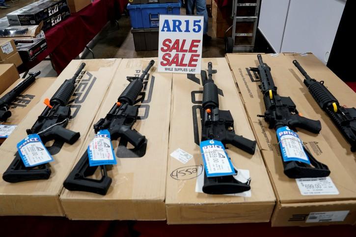 FILE PHOTO: AR-15 rifles are displayed for sale at the Guntoberfest gun show in Oaks, Pennsylvania, U.S., October 6, 2017.   REUTERS/Joshua Roberts - RC120D41AB00/File Photo