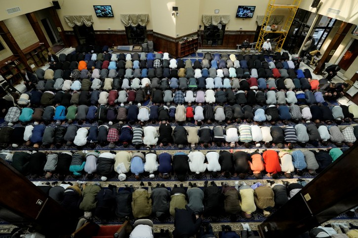 Members of the congregation pray during a Friday prayer at Dar Al-Hijrah Islamic Center in Falls Church, Virginia, U.S., March 15, 2019. REUTERS/Sait Serkan Gurbuz