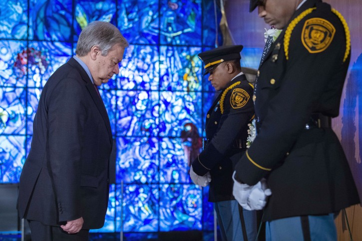 United Nations Secretary General Antonio Guterres, left, pays his respects during a wreath laying ceremony at United Nations headquarters, Friday March 15, 2019, for U.N. personnel that were aboard Ethiopian Airlines Flight ET302. AP