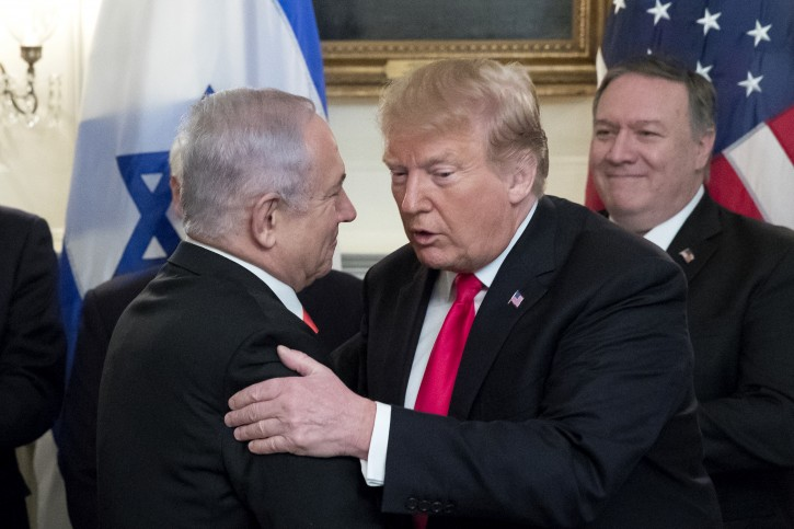 Prime Minister of Israel Benjamin Netanyahu (L) and US President Donald J. Trump (Front R) shake hands, as US Secretary of State Mike Pompeo (Back R) looks on; before Trump signs an order recognizing Golan Heights as Israeli territory, in the Diplomatic Reception Room of the White House in Washington, DC, USA, 25 March 2019.  EPA