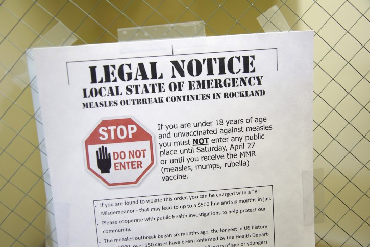 FILE - This Wednesday, March 27, 2019 file photo shows a sign explaining the local state of emergency because of a measles outbreak at the Rockland County Health Department in Pomona, N.Y.  (AP Photo/Seth Wenig)