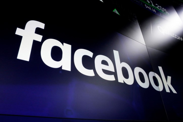 FILE - In this file photo dated March 29, 2018,  the logo for social media giant Facebook, appears on screens at the Nasdaq MarketSite, in New York's Times Square.  (AP Photo/Richard Drew, FILE)