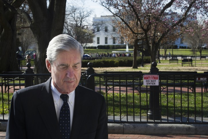 FILE - Special Councel Robert Mueller walks past the White House after attending services at St. John's Episcopal Church, in Washington, Sunday, March 24, 2019.  (AP Photo/Cliff Owen)