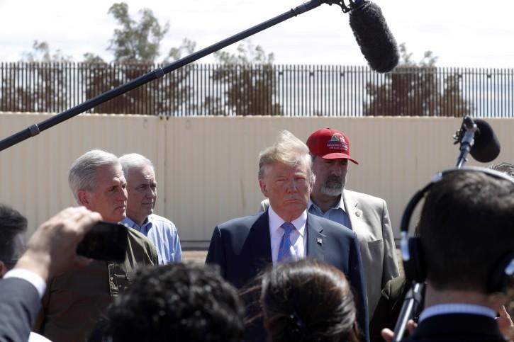 President Donald Trump exits Air Force One on arrival at Naval Air Facility El Centro, in El Centro, Calif., Friday April 5, 2019. (AP Photo/Jacquelyn Martin)