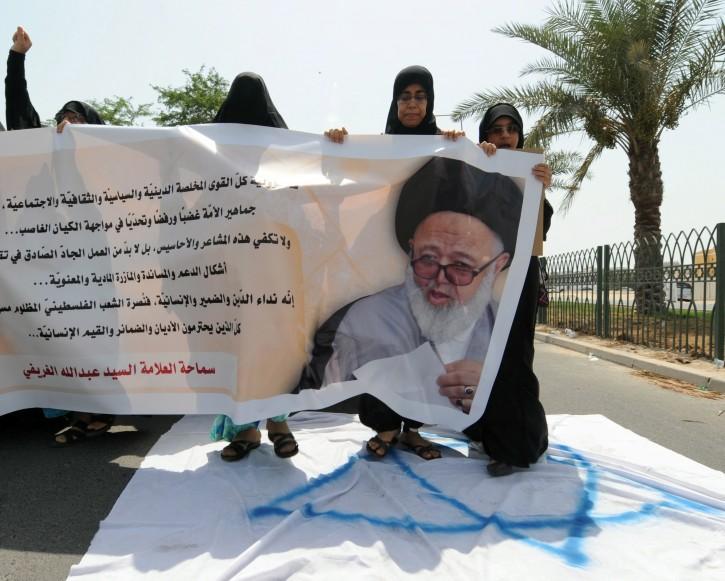 FILE - Bahraini protesters step on the Israeli flag during a march in Duraz north of the Bahraini capital Manama. EPA