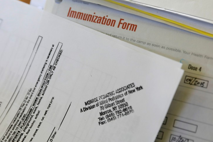 A camper's immunization form and physician's stamp is seen at the Rosmarins Day Camp and Cottages office in Monroe, New York, U.S., May 20, 2019. Picture taken May 20, 2019. REUTERS/Mike Segar