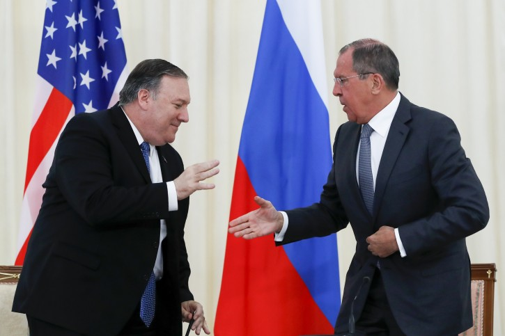 U.S. Secretary of State Mike Pompeo, left, and Russian Foreign Minister Sergey Lavrov shake hands after their joint news conference following the talks in the Black Sea resort city of Sochi, southern Russia, Tuesday, May 14, 2019. (AP Photo/Pavel Golovkin, Pool)