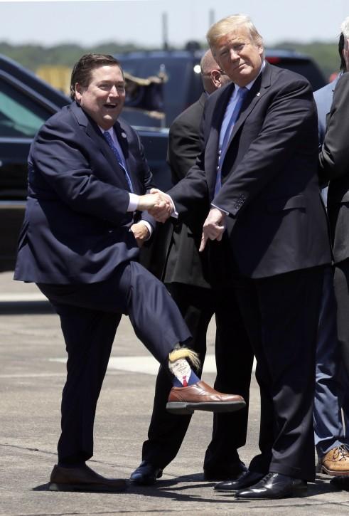President Donald Trump arrives at Chennault International Airport, Tuesday, May 14, 2019, in Lake Charles, La. (AP Photo/Evan Vucci)