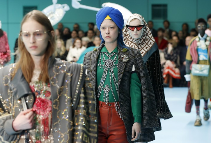 A model wears a creation part of Gucci women's Fall/Winter 2018-2019 collection, presented during the Milan Fashion Week, in Milan, Italy, Wednesday, Feb. 21, 2018. (AP Photo/Antonio Calanni)