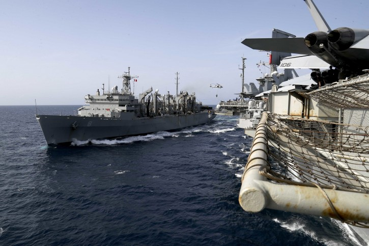 In this Sunday, May 19, 2019, photo released by the U.S. Navy, The fast combat support ship USNS Arctic (T-AOE 8) transports cargo to the Nimitz-class aircraft carrier USS Abraham Lincoln (CVN 72) during a replenishment-at-sea. (Mass Communication Specialist 3rd Class Jeff Sherman/U.S. Navy via AP)