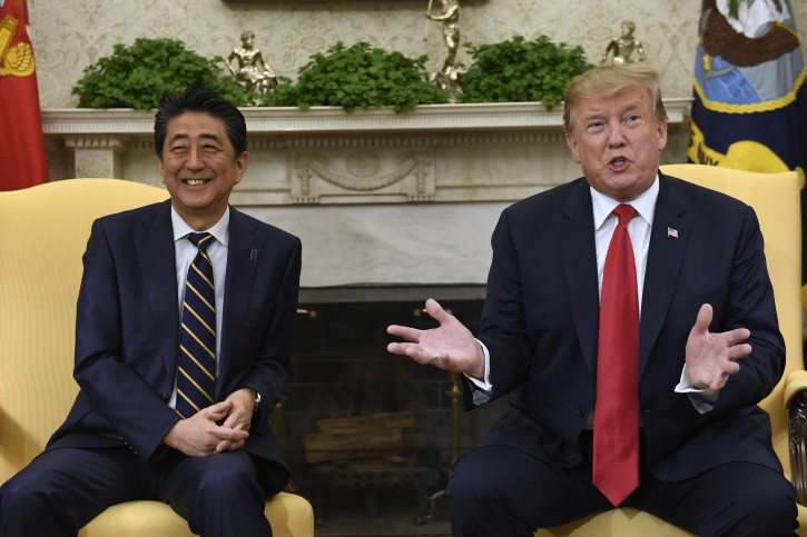 FILE - President Donald Trump, right, speaks while meeting with Japanese Prime Minister Shinzo Abe, left, in the Oval Office of the White House in Washington, Friday, April 26, 2019.  (AP Photo/Susan Walsh)