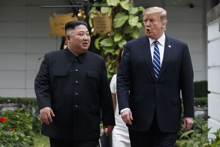 FILE - President Donald Trump and North Korean leader Kim Jong Un takes a walk at the Sofitel Legend Metropole Hanoi hotel, Thursday, Feb. 28, 2019, in Hanoi. (AP Photo/ Evan Vucci)
