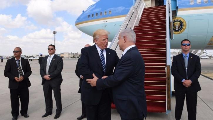FILE - Prime Minister Benjamin Netanyahu (L) and US President Donald Trump shake hands at Ben Gurion Airport